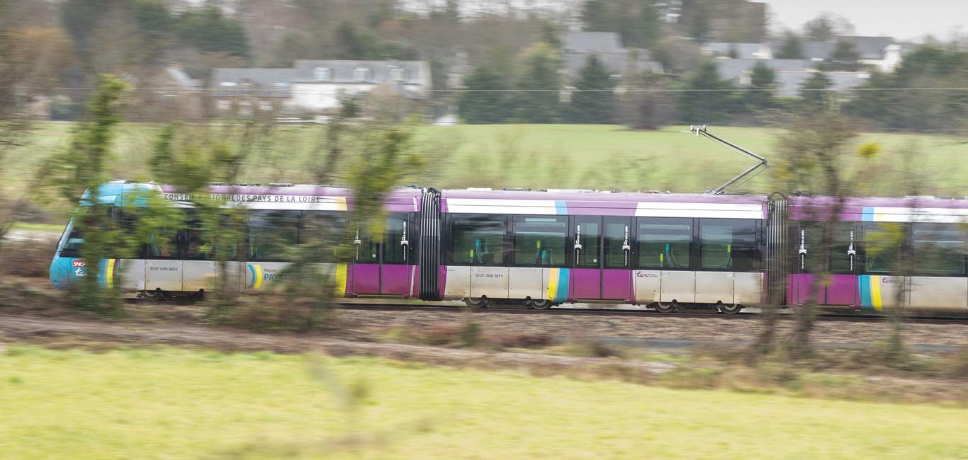 Citadis dualis Tram Train in countryside, Nantes, Châteaubriant, France.