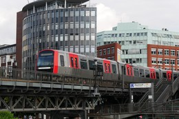 Hamburg Metro DT5 on viaduct leaving the elevated railway station Baumwall in Hamburg- Germany